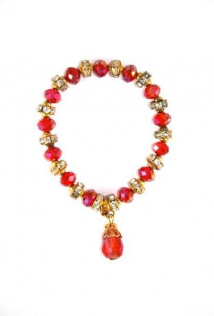 Flor roja y brazalete de oro del desierto